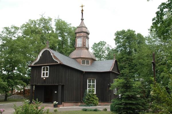 Herb Kościół pw. św. Wawrzyńca w Łomnicy