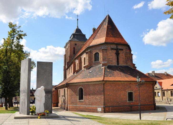 Herb Kościół pw. Wniebowzięcia NMP i św. Stanisława Biskupa i Męczennika we Wrześni